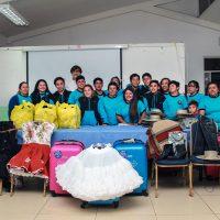 Hijos del Mar junto a Mauricio Acuña con las donaciones de Collahuasi.